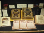 A display of family Bibles and certificates for recording births, deaths, and marriages. Courtesy Whitworth University.