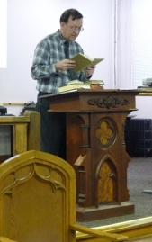 Professor David I. Roberts reading a passage from a 20th century Bible.