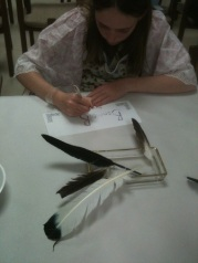 Bonnie tries  her hand at calligraphy during the New School Tuesday ink and quill program.